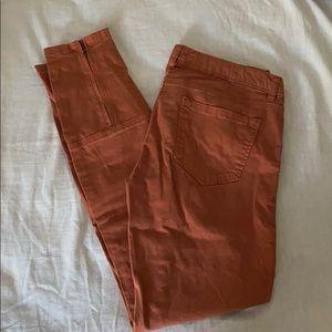 Dark orange skinny jeans
